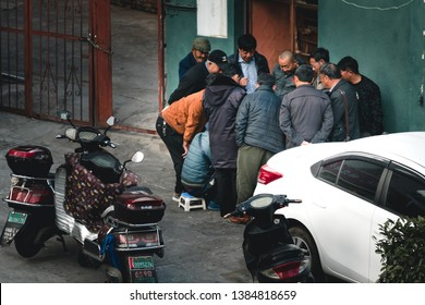 KUNMING, CHINA-2 JANUARY 2019 : Chinese people crowd around Conner at the building to play gambling