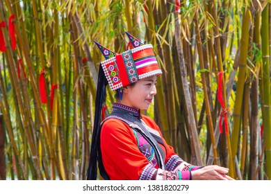 KUNMING, CHINA-MARCH,15, 2019: Portraiture image lady of Yi Nationality with Dressed In Ancient National Costume Performing in Yunnan Nationalities Village, Kunming City, Yunnan Province, China.