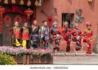 KUNMING, CHINA-MARCH,15, 2019:A Group Of Yi Nationality People Dressed In Ancient National Costume Performing in Yunnan Nationalities Village, Kunming City, Yunnan Province, China.