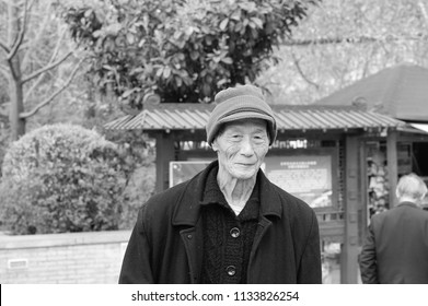 Kunming, Yunnan, China - 30 December 2017: An old chinese man in the Lotus Pond park