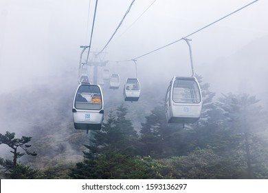KUNMING,CHINA-OCTOBER 26,2019: Cable Car takes tourists up to Jiaozi snow Mountain. Tourist attractions of Yunnan with beautiful nature