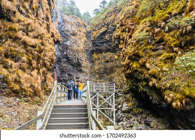 KUNMING,CHINA-OCTOBER 26,2019: Tourists on the way Go up to the viewpoint of Jiaozi snow Mountain Tourist attractions of Yunnan with beautiful nature