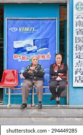 KUNMING-JUNE 30, 2014. Elderly in front of pharmacy shop. Elderly population (60 or older) in China is 128 million, one in every ten people, world's largest. China has 400 million elderly by 2050.