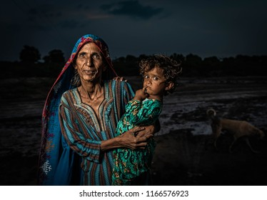 Kunri, Sindh/Pakistan-Aug 29,2018: Old lady with her grand daughter at Sindh