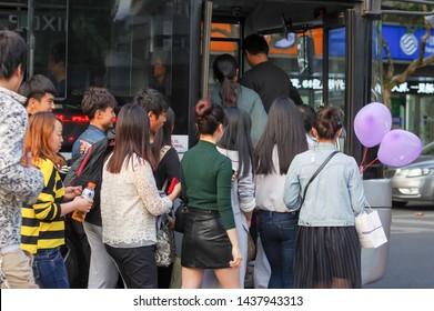 Kunshan City, Suzhou, JIANGSU / CHINA - Oct 25 2015: People Line up on the Public Bus