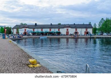 KUOPIO, FINLAND - JUNE 17, 2017: Scene of the passenger harbor, with locals and visitors, in Kuopio, Finland