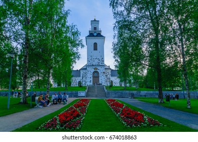 KUOPIO, FINLAND - JUNE 17, 2017: The Snellmanin Puisto park and the Lutheran Cathedral, with locals and visitors, in Kuopio, Finland
