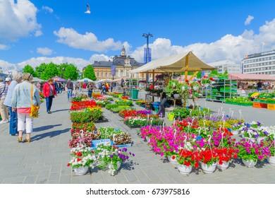 KUOPIO, FINLAND - JUNE 19, 2017: Scene of Kuopio Market Square, with stalls, the town hall, locals and visitors, in Kuopio, Finland