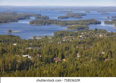 Kuopio village in Finland. Island, forest lake. Finnish landscape. Horizontal
