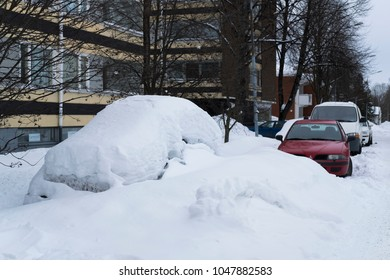 Kuopio/Finland-03/17/2018:  Car covered in snow on a a street in Kuopio, Finland.