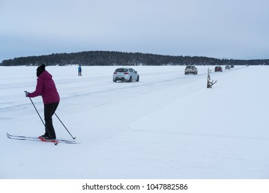 Kuopio/Finland-03/17/2018:  Cars and skiers seen on a ice road in Kuopio, Finland.