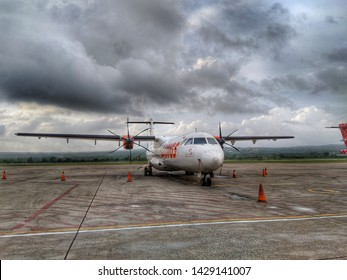 KUPANG, INDONESIA - December 12, 2018: Aircraft ATR 72 of Wings Air, parked in El Tari Airport in acloudy day