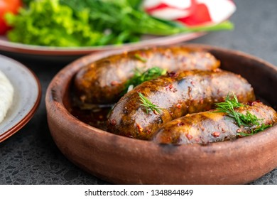 kupati homemade sausage traditional Georgian dish on the georgian traditional clay pot ketsi and ghomi with cheese suluguni