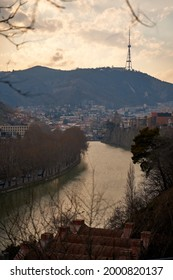 The Kura River flows through the city of Tbilisi. City landscape. - Shutterstock ID 2000820137