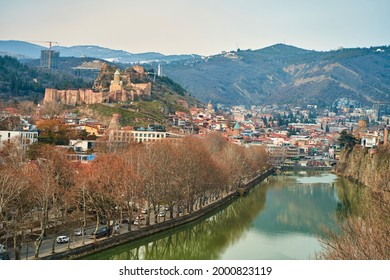 The Kura River flows through the city of Tbilisi. City landscape. - Shutterstock ID 2000823119