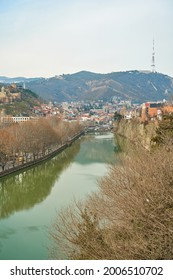 The Kura River flows through the city of Tbilisi. City landscape. - Shutterstock ID 2006510702
