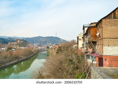 The Kura River flows through the city of Tbilisi. City landscape. - Shutterstock ID 2006510705