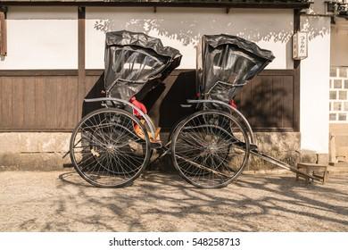 KURASHIKI, JAPAN- DEC 6 : Traditional rickshaws at Kurashiki Bikan historical quarter on Dec 6, 2016 in Kurashiki, Okayama, Japan.