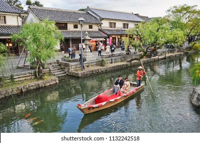 KURASHIKI, JAPAN - November 19, 2017: Couple during Wedding ceremony on the old-fashioned boat along the Kurashiki canal in  Kurashiki Canal of Kurashiki, Japan.