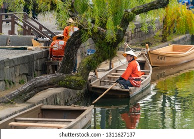 Kurashiki , Japan - November 25,2018 : Boat driver sitting in old-fashioned boat along the Kurashiki canal