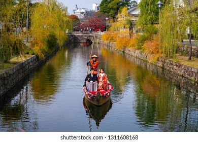 Kurashiki , Japan - November 25,2018 : The Japanese traditional wedding ceremony on the old-fashioned boat along the Kurashiki canal in Bikan district of Kurashiki city, Japan