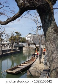 Kurashiki, Japan-Circa March 2016: Old days scenery is still mostly preserved in Kurashiki town and there is sailing activity available for tourists to sightseeing the town along Kurashiki River.