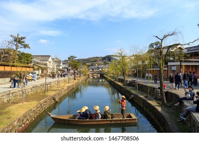KURASHIKI, OKAYAMA, JAPAN – MARCH 21 : Local people escorting tourists to see the city by boat in the Kurashiki city of Okayama Prefecture on March 21, 2019 in Okayama, Japan.