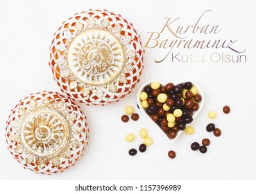 Kurban Bayramı sacrifice festival, Islamic Arabic candle and chocolate sugar. Kurban bayraminiz kutlu olsun means happy festival of sacrifices