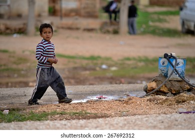 Kurdish boy walking through streets of Kobani 3.4.2015, Kobani, Syria