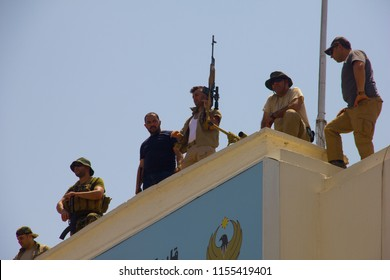 Kurdish Soldiers on top a building opposite Erbil's Governorate that Islamic State gunmen attacked Erbil, Iraqi-Kurdistan July 23th 2018