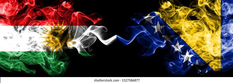 Kurdistan vs Bosnia and Herzegovina, Bosnian smoke flags placed side by side. Thick colored silky smoke flags of Kurds and Bosnia and Herzegovina, Bosnian