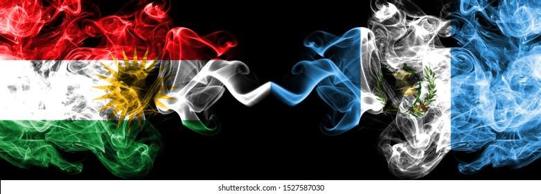 Kurdistan vs Guatemala, Guatemalan smoke flags placed side by side. Thick colored silky smoke flags of Kurds and Guatemala, Guatemalan