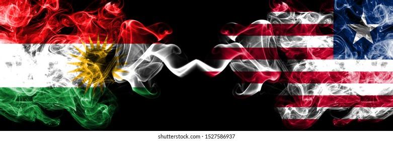 Kurdistan vs Liberia, Liberian smoke flags placed side by side. Thick colored silky smoke flags of Kurds and Liberia, Liberian