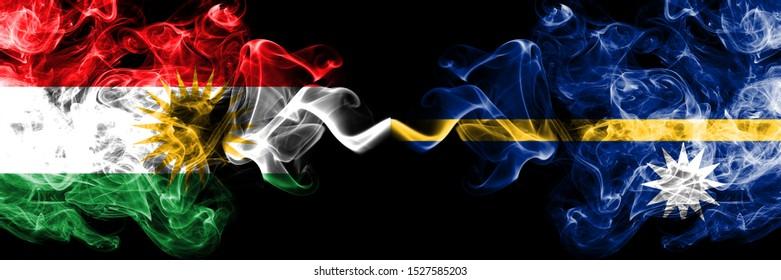 Kurdistan vs Nauru smoke flags placed side by side. Thick colored silky smoke flags of Kurds and Nauru