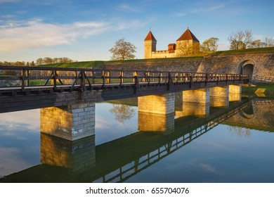 Kuressaare castle with bridge over the moat in beautiful sunrise light. Saaremaa, Kuressaare