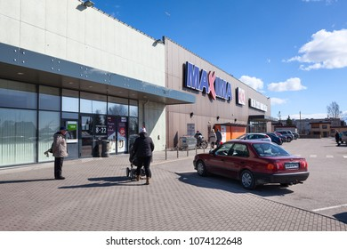 KURESSAARE, ESTONIA - CIRCA MAR, 2018: Main entrance of building of supermarket Maxima XX with visitors. It is one of the largest shops is on Saaremaa island