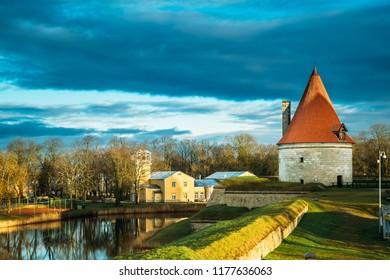 Kuressaare, Saaremaa, Estonia. Cannon Tower On Territory Of Episcopal Castle In Sunset. Traditional Medieval Architecture, Famous Attraction Landmark.