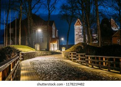 Kuressaare, Saaremaa Island, Estonia. Cabblestone Road Near Episcopal Castle In Night Illuminations.