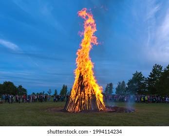 KURESSAARE, SAAREMAA ISLAND, ESTONIA - JUNE 23, 2017: Traditional large bonfire to celebrate the Jaanipaev (Jaan's Day). This Estonian public holiday corresponds to the English Midsummer Day.
