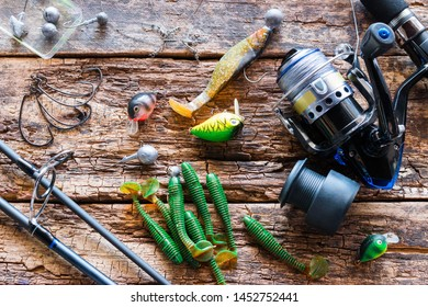 Kurgan, Russia, June 10, 2019 spinning and accessories for fishing on a wooden background