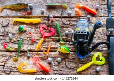 Kurgan, Russia, June 10, 2019 spinning and silicone bait for fishing on a wooden background