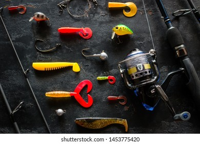 Kurgan, Russia, June 10, 2019 fishing rod spinning and various bait for fishing on a black background