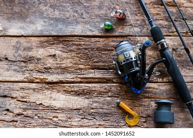 Kurgan, Russia-June 19, 2019 spinning and fishing lures on a wooden background with space for text
