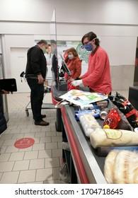 Kurim, Czech Republic, April 15, 2020. The store cashier serves customers during quarantine due to coronavirus infection.