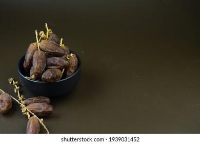 Kurma or Dates fruits, popular sunnah food in Ramadan month for breakfasting. Islamic background for text and template. Ramadan Kareem, Eid Mubarak celebration.