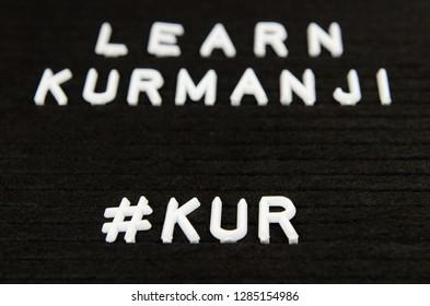 Kurmanji, Northern Kurdish language sign on black background with hashtag