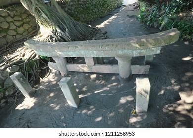 Kurokami shrine in Sakurajima, Kagoshima, Japan. The torii gate of this shrine is buried by volcanic ashes.