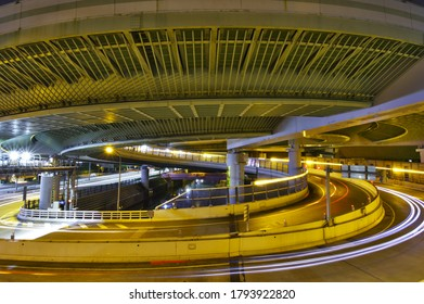 """Kurokawa"" in Nagoya, Aichi / Japan - August 9, 2020 : Night view of the beautiful spiral highway interchange. Japanese written on the road is written as ""Highway exit""."