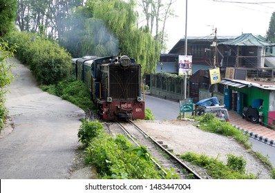 Kurseong, Darjeeling: May 29 2019: The toy train pulled by diesel locomotive  between Siliguri and Darjeeling passes through the most scenic route in the himalayas.