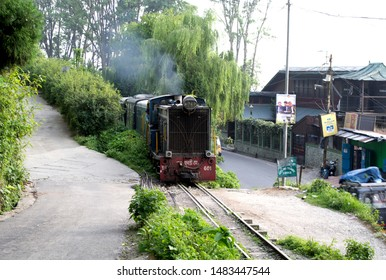 Kurseong, Darjeeling: May 29 2019: The toy train pulled by diesel locomotive  between Siliguri and Darjeeling passes through the most scenic route in the himalayan railway segment.